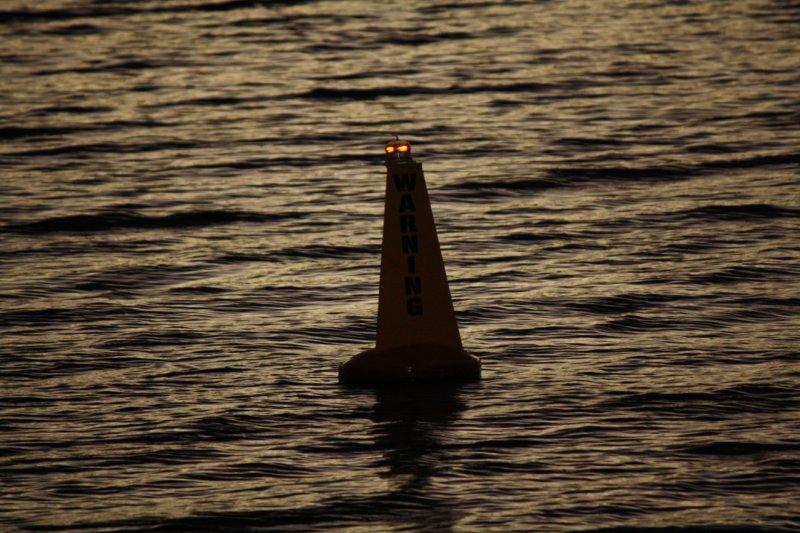 buoy at night