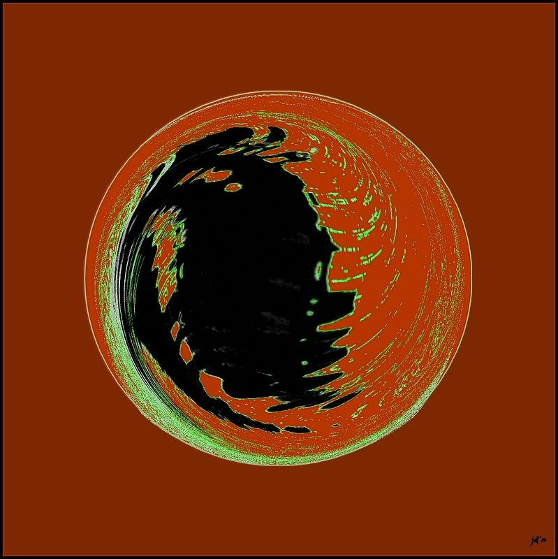 Une sphère noir et rouge dans un carré