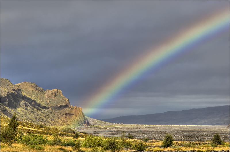 Rainbow over icelandic valley
