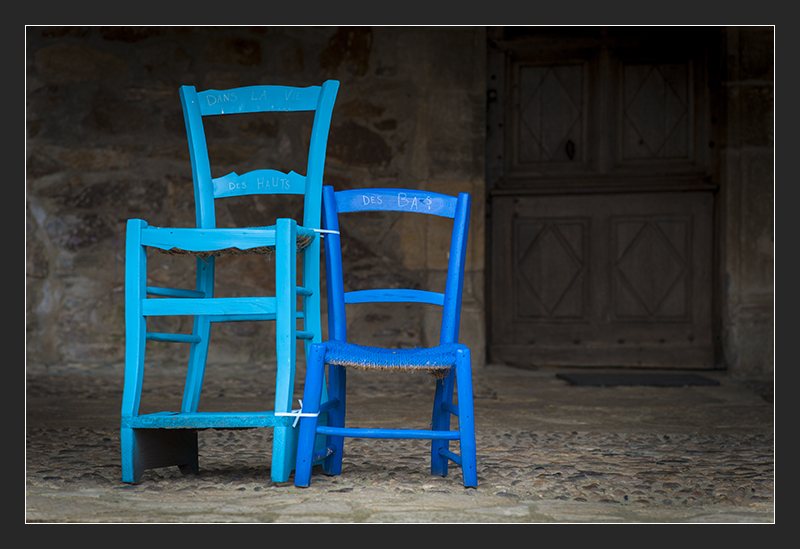 Blue chairs in the street