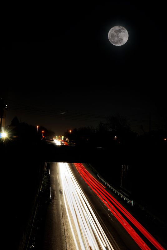 Full moon over the trafic