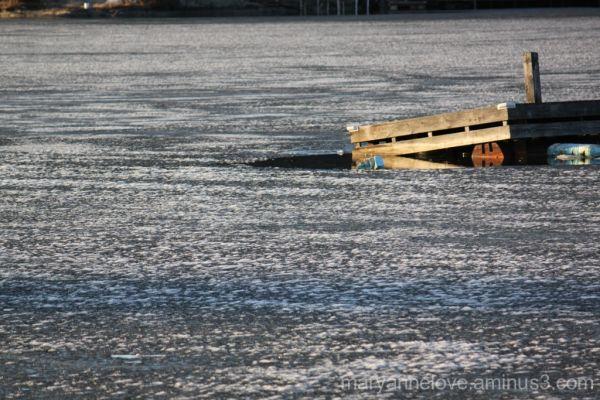 Broken dock from winter ice.