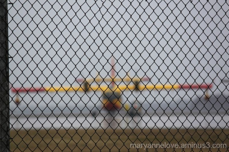 Water Bomber Behind A Fence