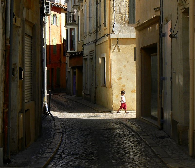 a boy walking in the streets of Tarascon