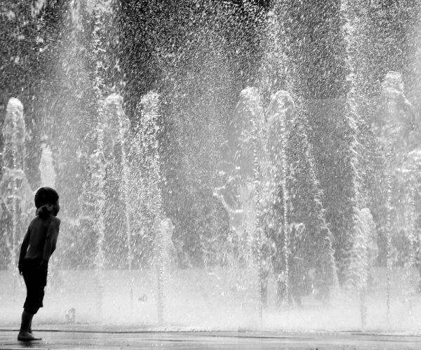 kid facing a wall of water