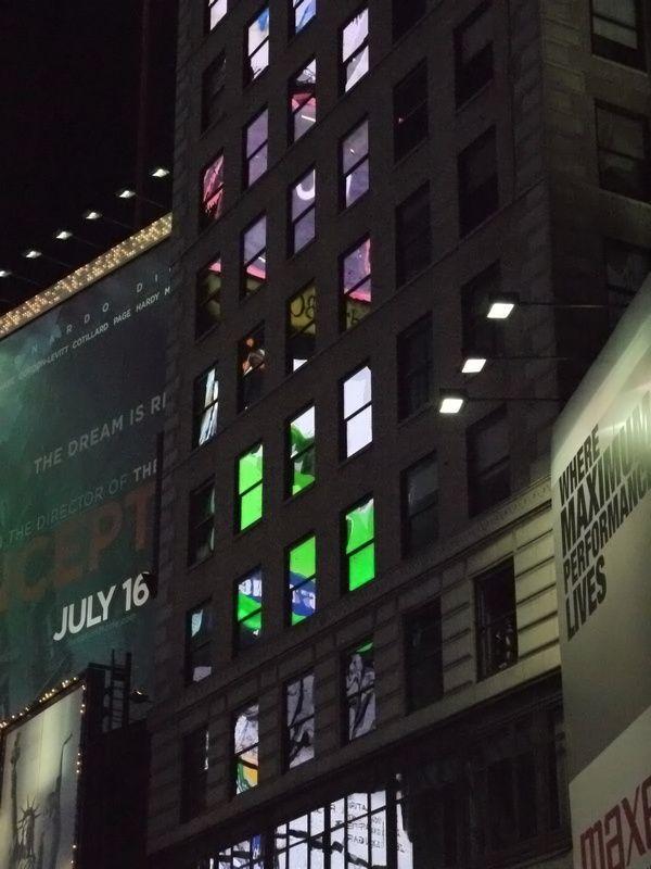 reflection of advertisement lights on windows
