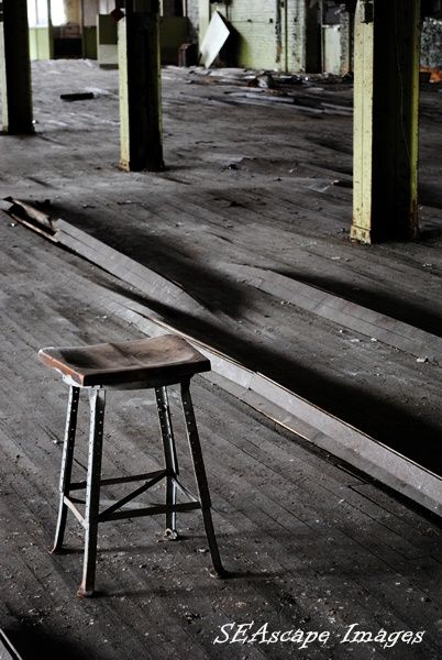lonely stool in abandoned factory