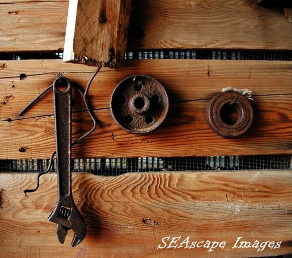 Rusty tools on corn crib wall