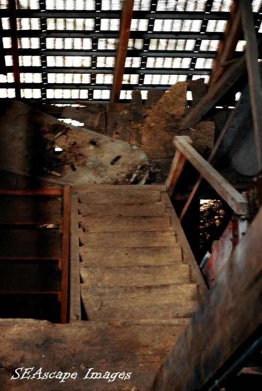looking down the staircase in a corn crib.