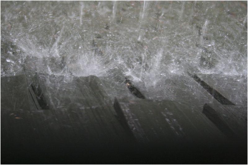 heavy rain falls on a cedar roof