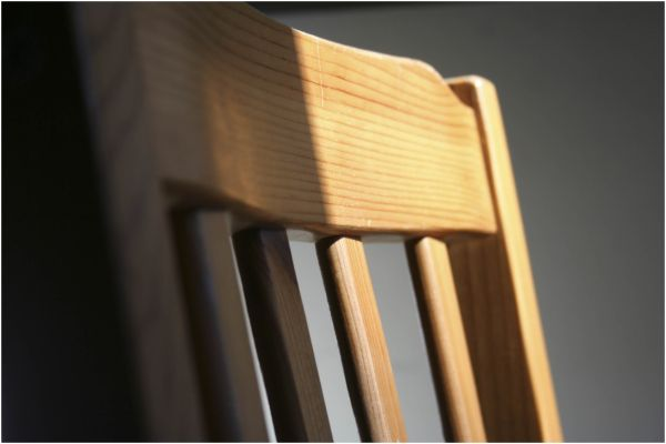 wooden chair in half light