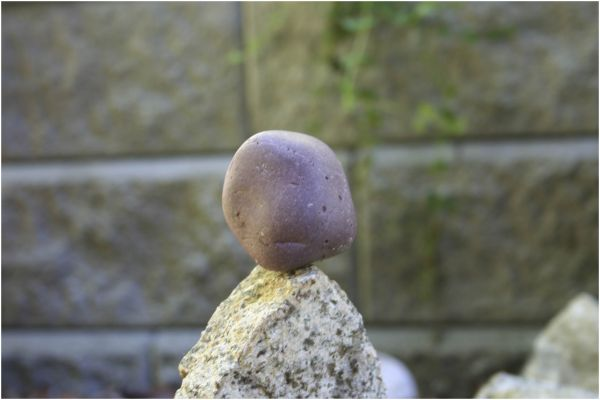one rock balanced upon another