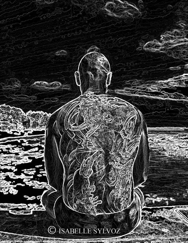 Tattoo man on the beach