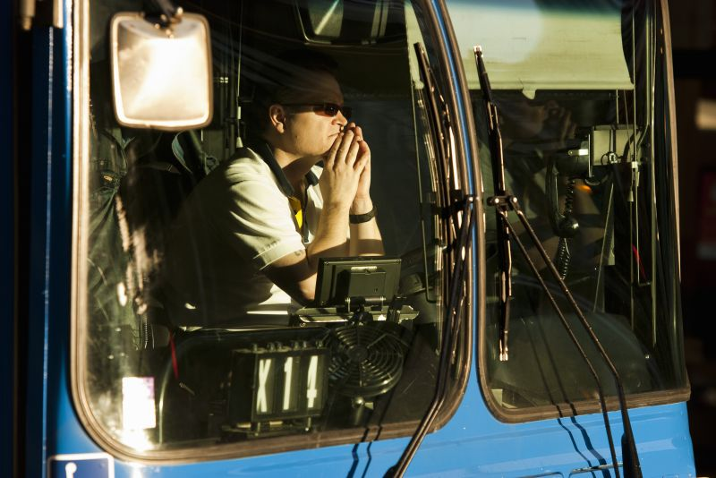 Bus Driver waiting at red light