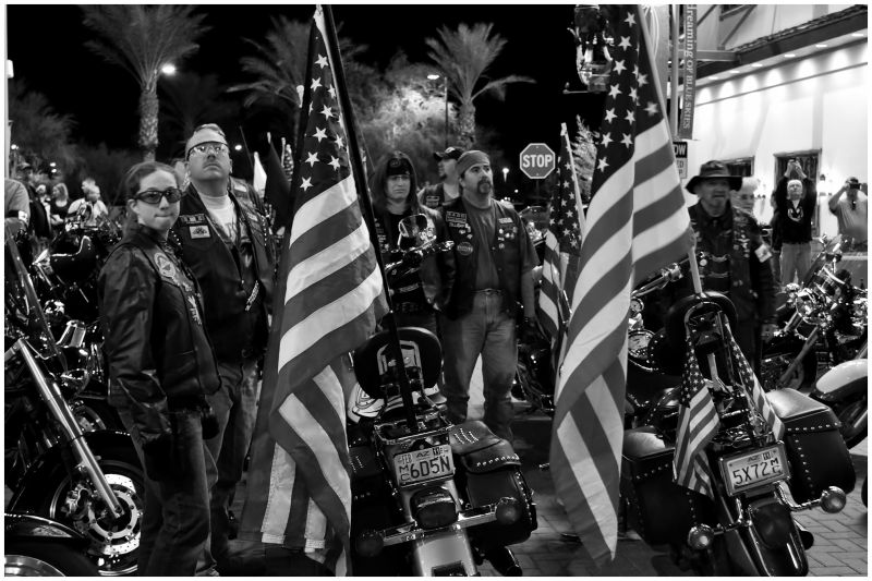 Bikers pause to salute the flag