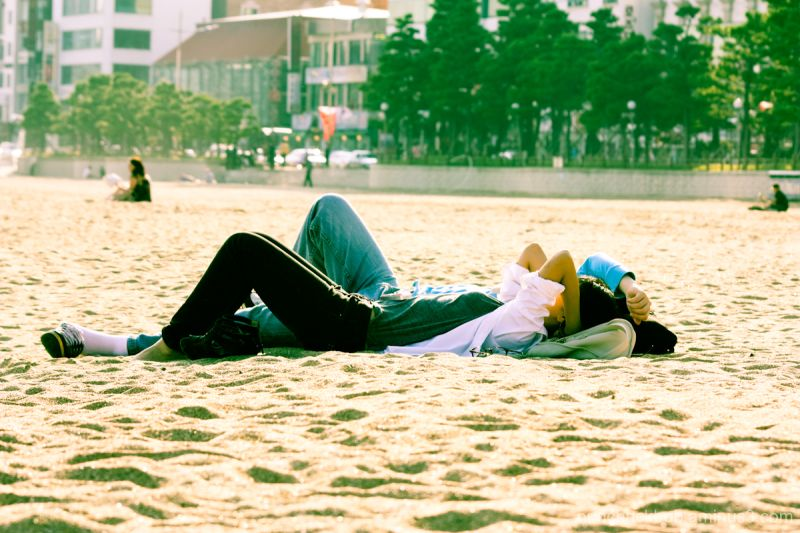 people at the beach chilling