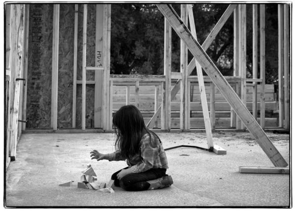girl builds with blocks