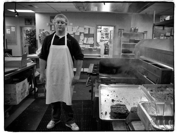 boy in soup kitchen