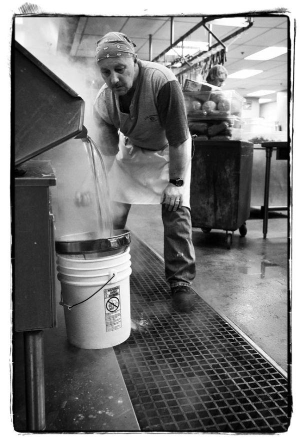 Man drains hot water