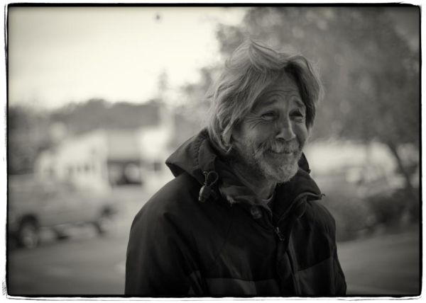 homeless man smiling