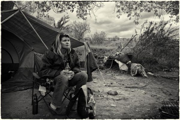homeless woman in her camp