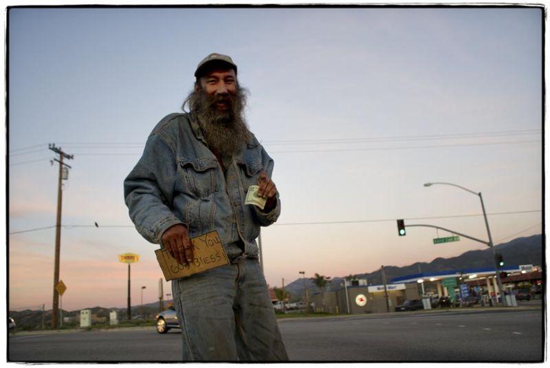 homeless man gets money