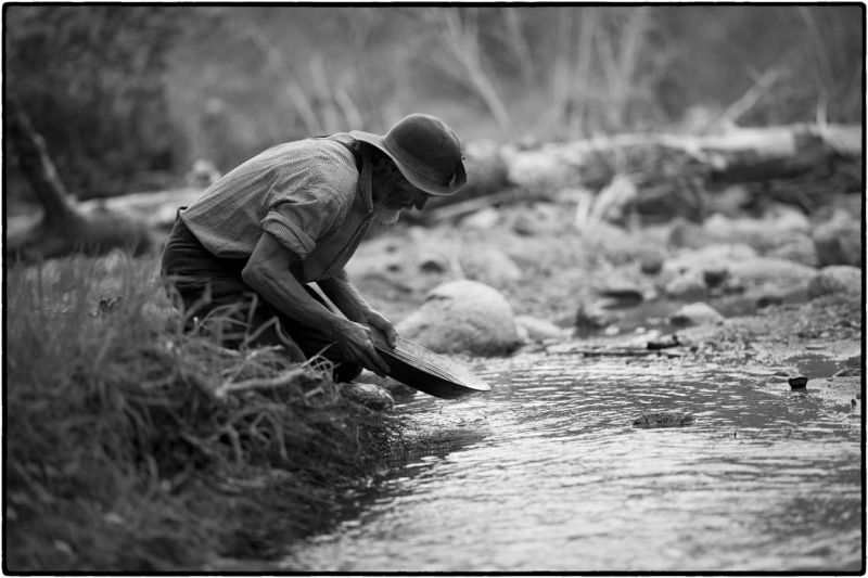 old man panning for gold