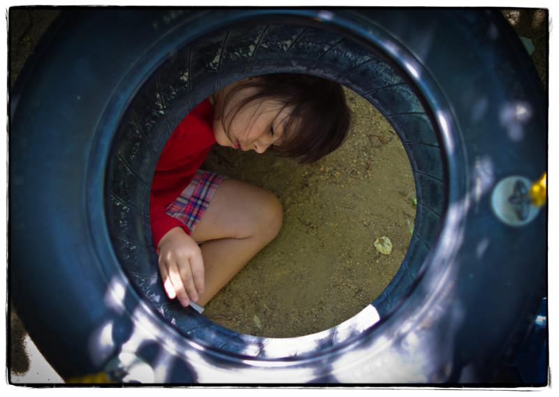 child under tire