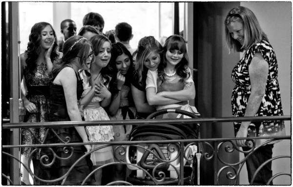 girls looking at baby