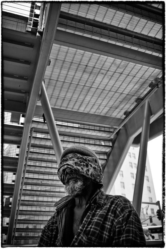 homeless man with bandana