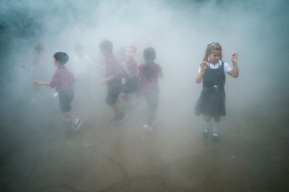 children in mist