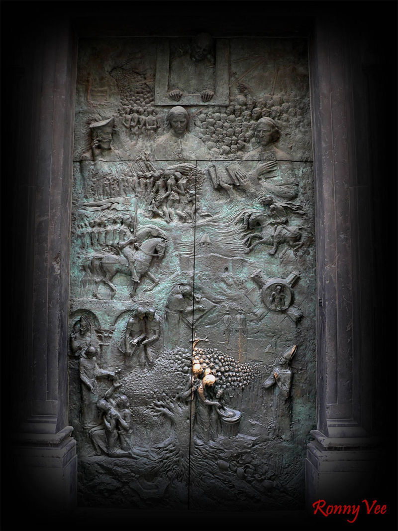 very strange scene on a church door...