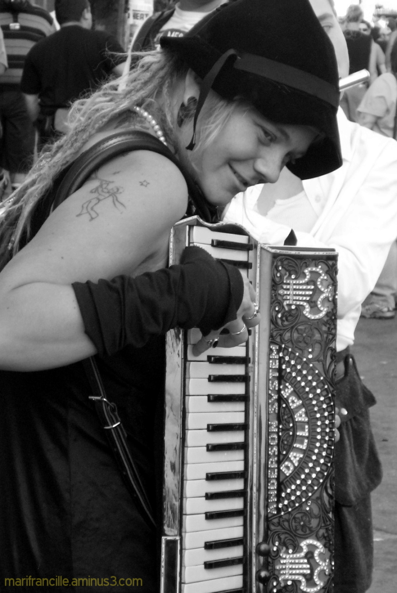 street busker, accordion player, black and white