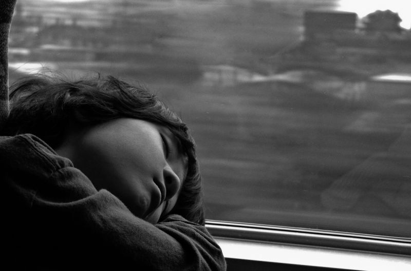 child sleeping in moving train