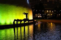 A night shot of a statue in Hong Kong