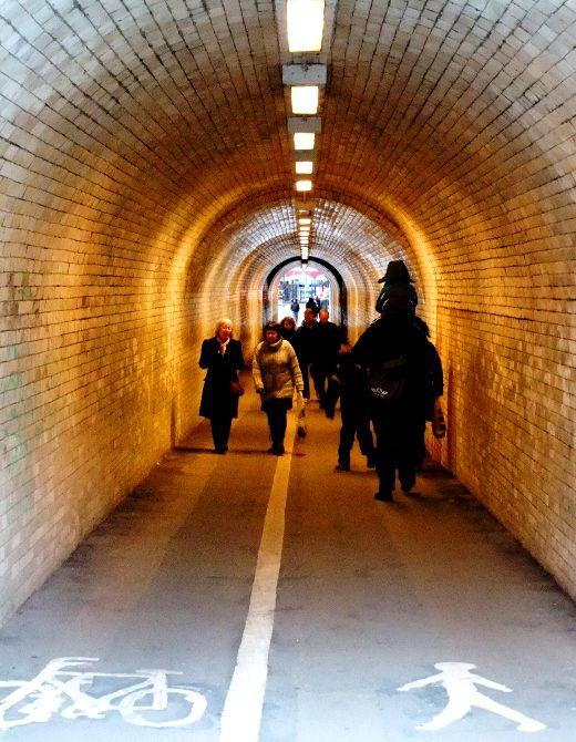 people in pedestrian tunnel