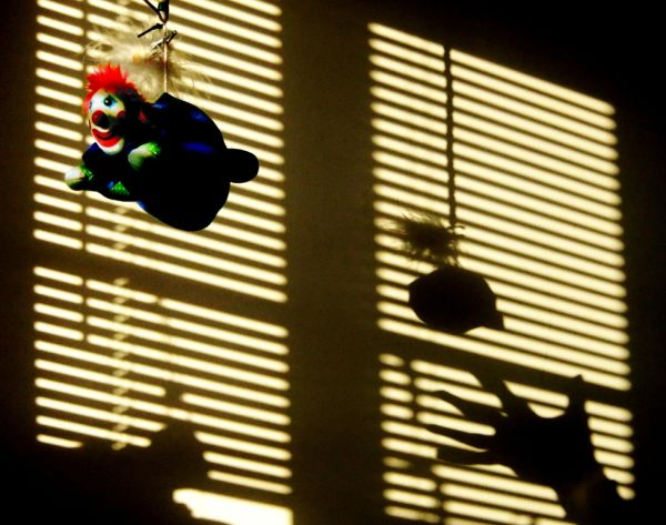 clown mobile with blind shadow and hand
