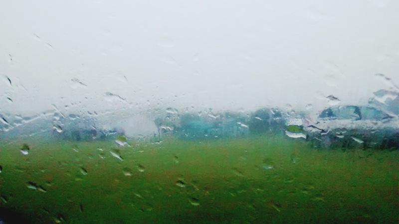 Shot of campsite taken through car window in rain