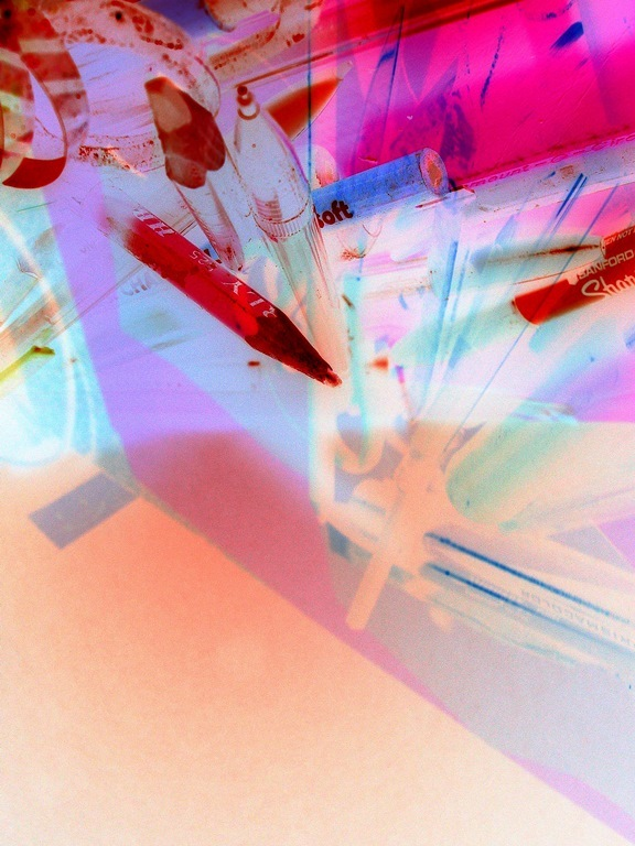 Experimental inverted photo of art supplies