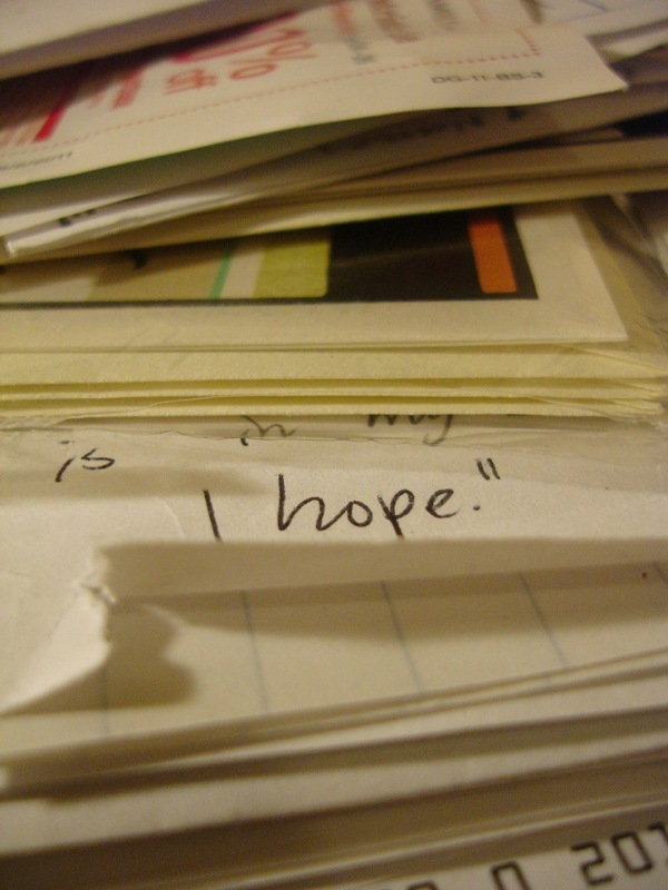 photo of a little message hidden in pile of paper