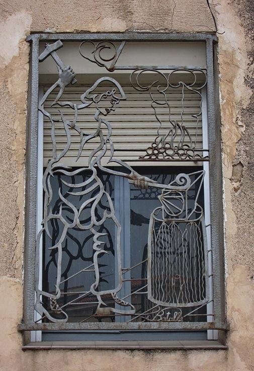 Finestra de ferro forjat (amb forjador)