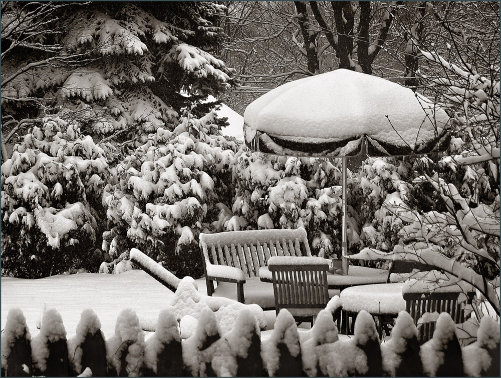 patio furniture covered in snow