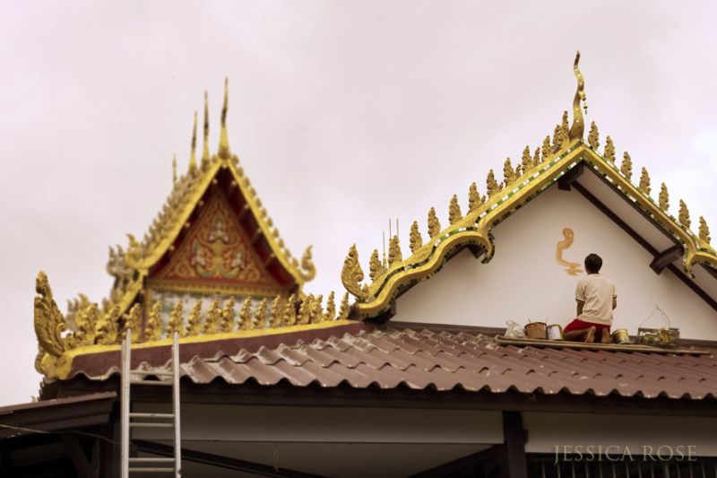 Painting a new Buddha image in Vientianne, Laos