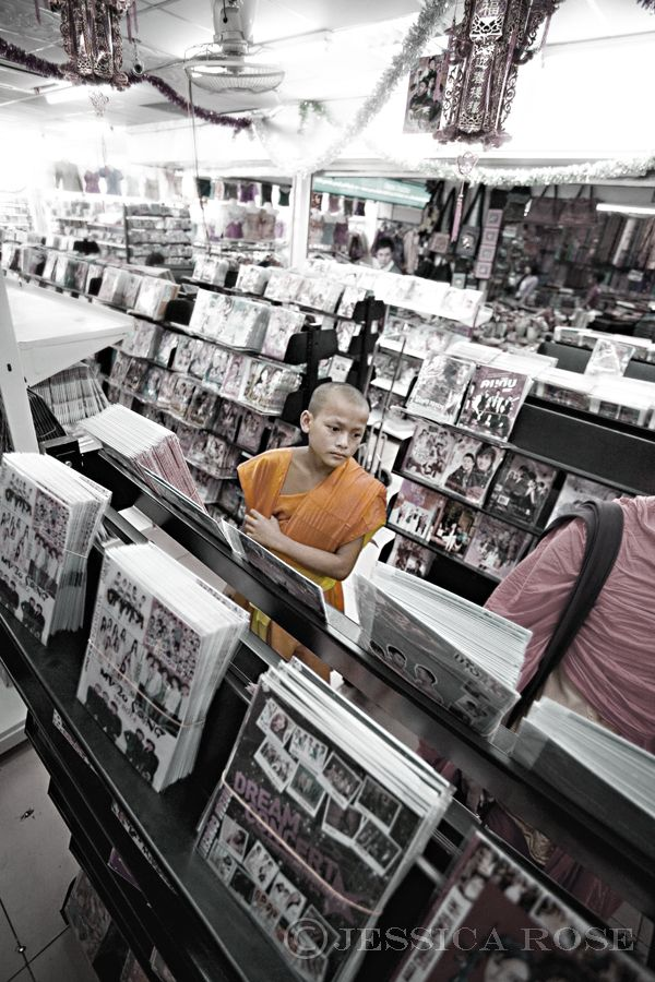 A young Buddhist monks visits a mall