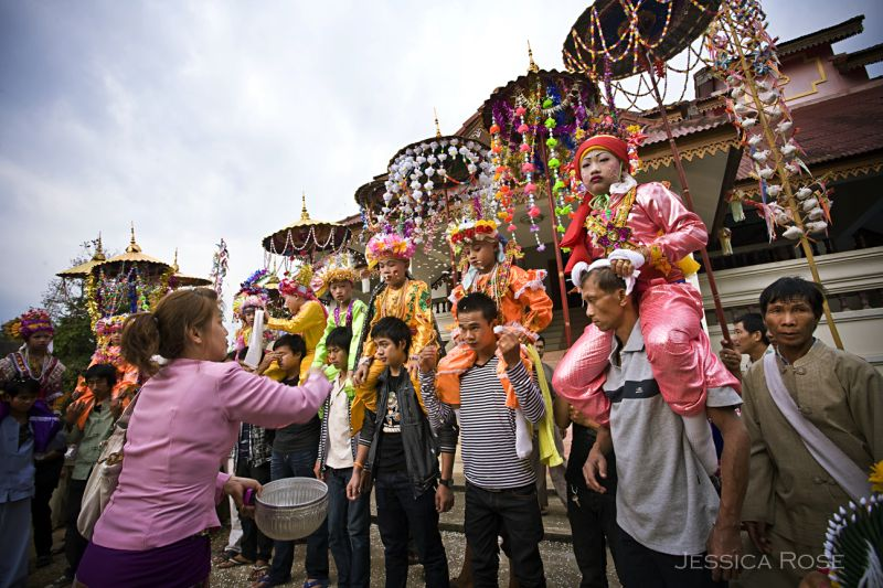 Tai Yai boys are paraded on the shoulders