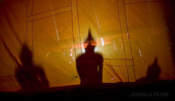 Buddha statues in shadow