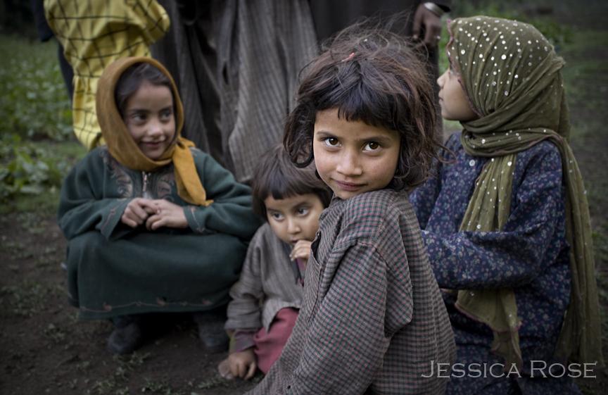 A young Gujar girl strikes a gaze.
