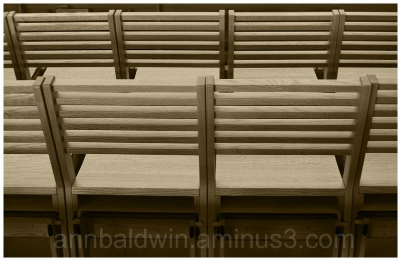 Rows of wooden chairs