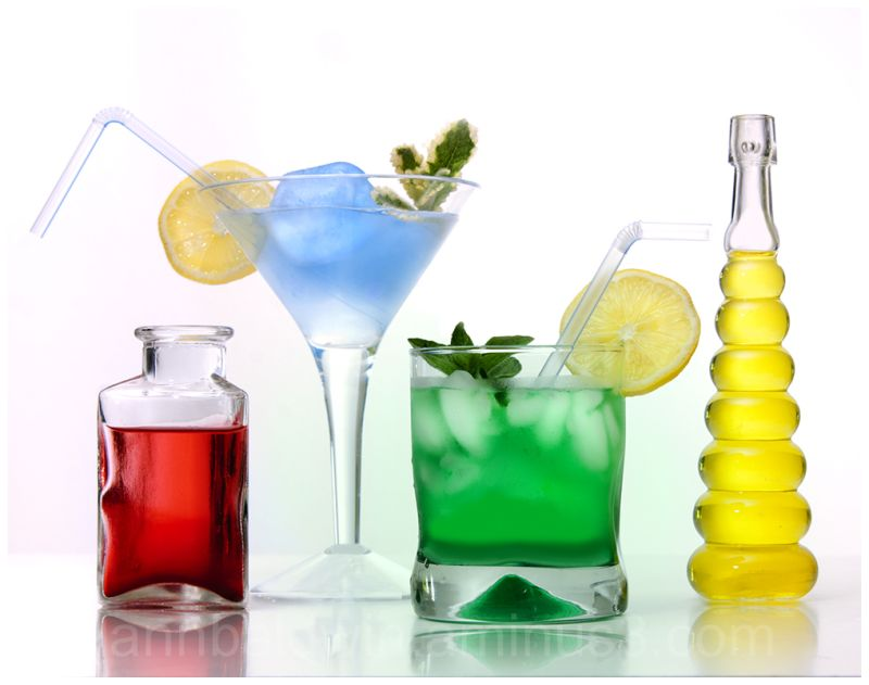 Colorful cocktails in decorative glass bottles