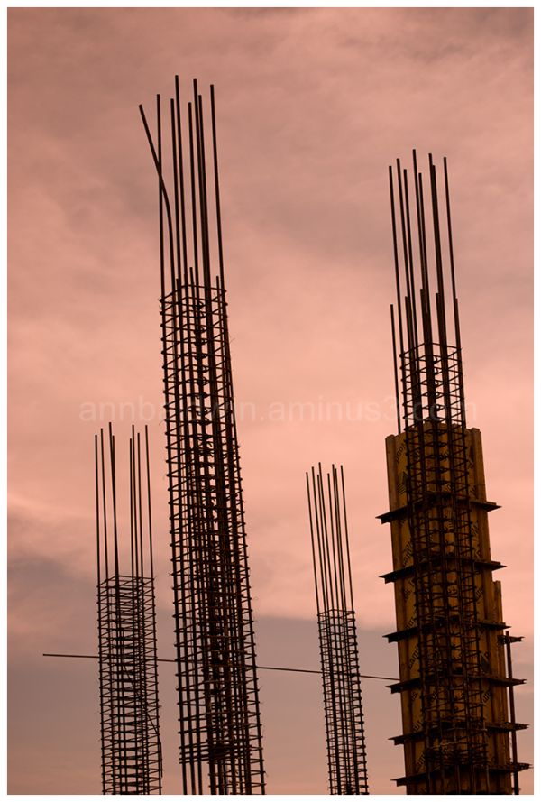 Steel towers against a sunset sky